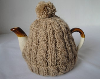 bobble teapot cover, four-cup teacozy, light-brown tea-cosy, knitted teapot cover, woolly hat tea cozy, fudge brown teacosy, cabled tea-cosy
