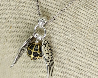 SS043- Black diamond Sterling Silver Quidditch inspired winged golden ball necklace