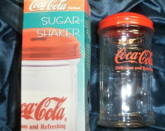 COCACOLA SUGAR SHAKER New in Box shipped by Priority Mail with tracking