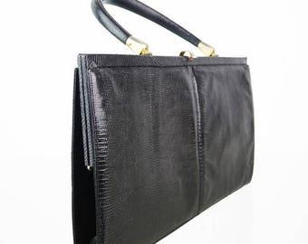 Elongated vintage real leather handbag