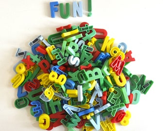 vintage lot of plastic magnetic letters and numbers