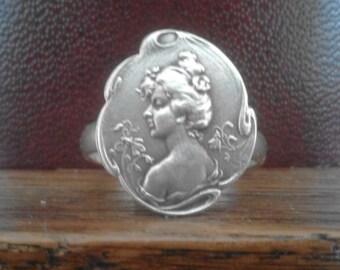 Art Nouveau silver plate depicting a woman flower ring