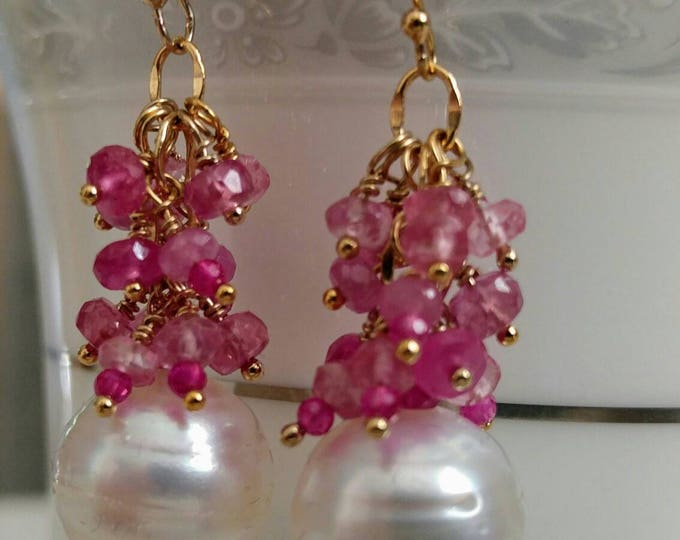 White South sea pearls, pink sapphire earrings. Large White South sea pearls, pink sapphire clusters dangle on gold wire. Austrailian pearls