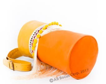 Bocus 'Let's play'. Yellow & orange leather with sequence, pompons and fringes.