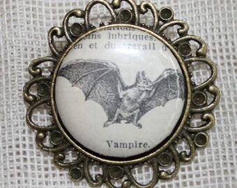 Brooch piece unique made with an original illustration of a 1949 Larousse - Cabochon 25 mm Vampire Bat