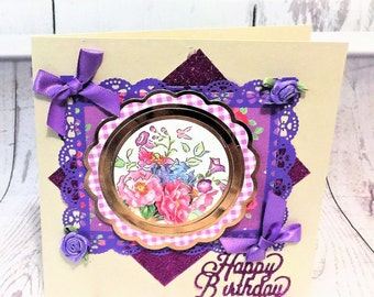 Beautiful detailed female birthday card with dahlia purple lace frame and bows.