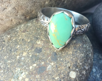 Sterling Silver with Turquoise stone on an oxidized floral band