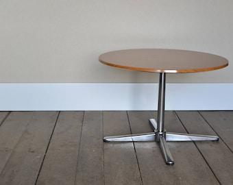 Vintage 1970's round formica side table on a metal pedestal base