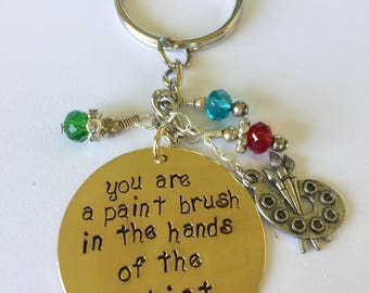 You are the paint brush in the hands of the Artist Keychain