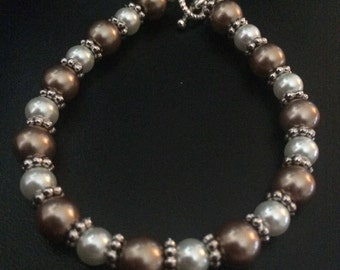Bronze and White Glass Pearl Bracelet with Silver Beads and Silver Toggle Clasp