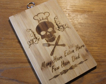 """Custom Cutting Board """"Many Have Eaten Here Few Have Died""""  Bring humor to the kitchen.  Fun Gift for the 1st. time homemaker."""