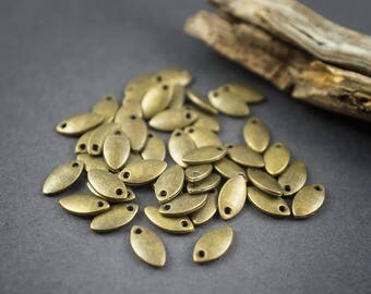 20 pcs - small sequins charms navettes, Teardrop, oval leaves in bronze metal - 8mm x 4mm