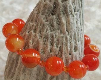 Dark orange agate beaded bracelet with orange crystals