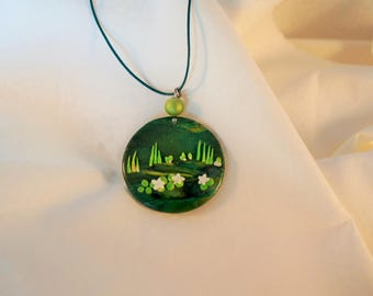 Green round pendant landscape water lilies and stylized herbs, green pendant, embossed lilies white green necklace, layering necklace