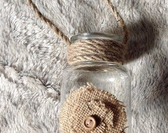 Burlap and rope decorated glass jar