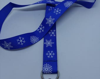 For white snowflakes and blue grosgrain badge strap