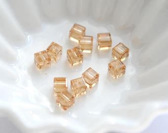 Lot 4 cube beads 4mm Crystal Swarovski/nightblue opalescent reflects pastel orange colors