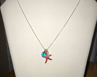 """coral colored starfish charm necklace on 24"""" sterling silver plated chain"""