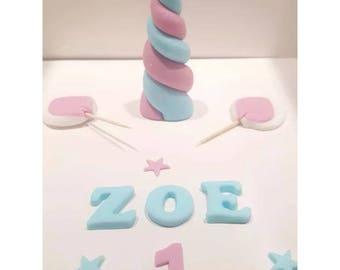 Pink and blue handmade edible unicorn cake topper set