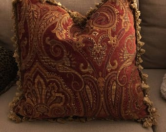 Beautiful, elegant tapestry pillow framed in gold cotton tassels.