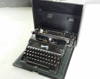 Rheinmetall typewriter - 50's - mid century - german ware - made in Germany - iron maden - heavy ware - great condition - lockable box