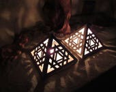 Pyramid ceramic candle holder / shadow lamp with symmetric merkaba patterns