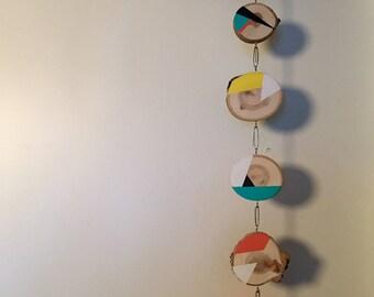 Hanging geometric wood-slice mobile
