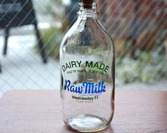 Glass bottle designed like a vintage M