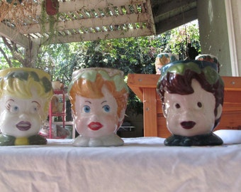 3 different DIY painted peter pan cups from the '50s/'60s