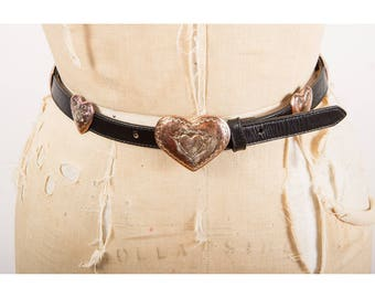 Vintage heart belt / 1990s skinny leather belt with engraved heart shaped conchos / S M