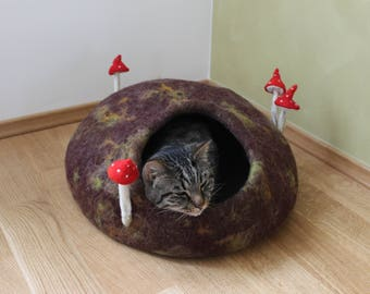 cat house with mushrooms