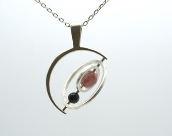 the Saturn Gryoscope necklace - Sunstone + Onyx