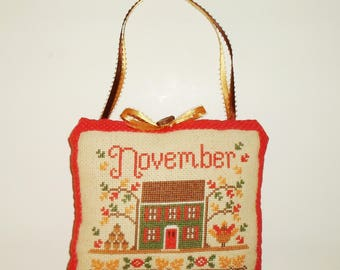 Completed Cross Stitch November Cottage Hanging Doorknob Pillow