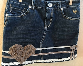 Girls 12 Reg denim skirt with heart and bows.