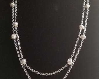 Wire wrapped white glass beads, delicately suspended in chain