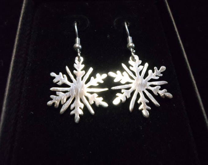 Snowflake earrings quarter size