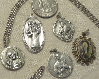 Lot of five vintage Art Deco era sterling silver Saint Anthony Gerard Christ Madonna Catholic Christianity religious medal pendant medals