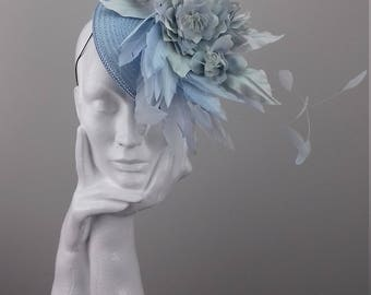 Pale blue elegant and dramatic small hat suitable for Ascot, Dubai World Cup, The Curragh, Cheltenham Races,Melbourne Cup, wedding guest