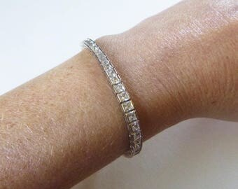 Modern silver tone white princess cut open back crystal bracelet 8 inches
