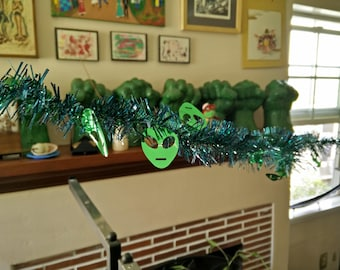 Independence Day Alien invasion tinsel 9' garland blue green tinsel foil alien faces July 4 sci fi Father's day birthday party decoration