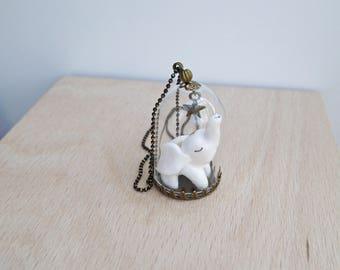 collier sautoir ou globe décoratif en verre mon bébé éléphant blanc