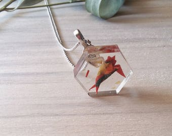 Origami mini-swallow necklace. Swallow incased in a resin hexagon shaped pendant.