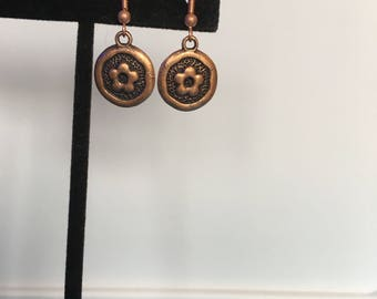 Round copper flower earrings