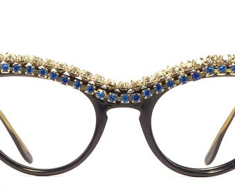 Vintage eyewear. Cat eye style. Oh my goodness! Look at those spectacular rhinestones on a gloss black frame! Made in the 1950's. Beauty!