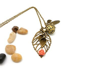 A scent! Necklace has perfume leaf flower salmon Orange charms and co.