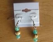 Glass and bone dangle earrings