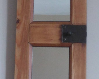 Recycled window converted into a rustic mirror