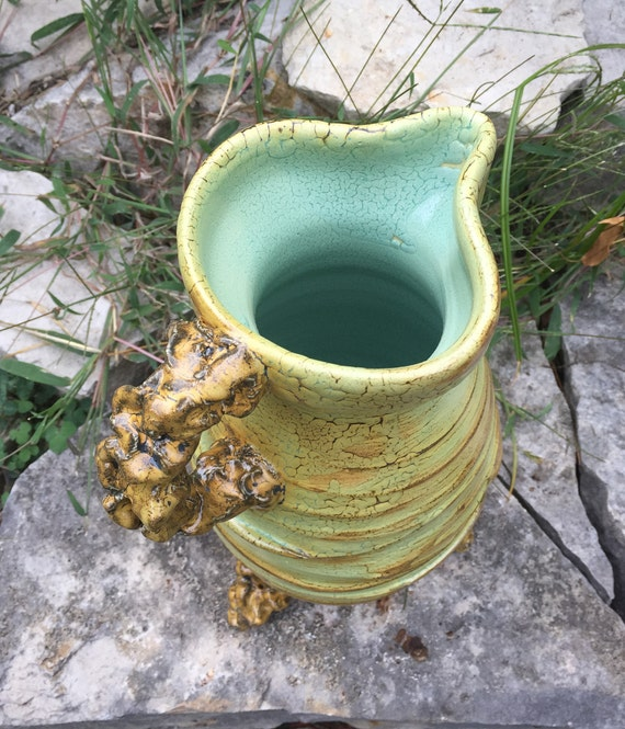 medium sized ceramic pitcher in beige and pale green