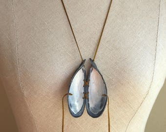 leather and mussel shell medallion necklace