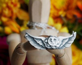 Glorious tattoo inspired winged sun necklace hand made fine silver on a sterling silver chain...